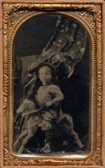 Young Boy on Hobby Horse with a draped person hidden behind him, c. 1867