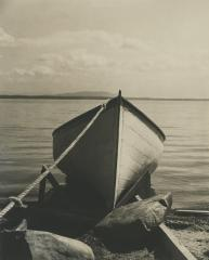 Bow of a small boat on the shore, circa 1940